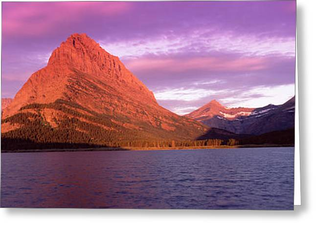 Many Glacier Greeting Cards - Lake With Mountains At Dusk Greeting Card by Panoramic Images