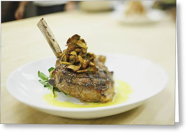 Differential Focus Greeting Cards - Lamb Chop On A Plate In A Restaurant Greeting Card by Eric Kulin