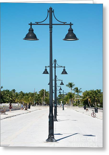 Lamp Posts White Street Pier Key West Greeting Card by Ian Monk