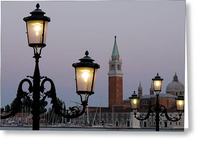 Classical Style Greeting Cards - Lampposts Lit Up At Dusk With Building Greeting Card by Panoramic Images