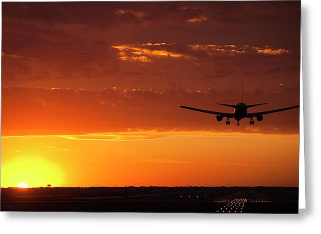 Plane Art Greeting Cards - Landing into the Sunset Greeting Card by Andrew Soundarajan