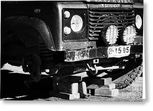 Steering Greeting Cards - landrover with suspension damage on bricks in Punta Arenas Chile Greeting Card by Joe Fox