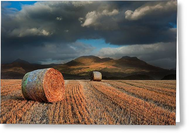 Hay Bales Greeting Cards - Landscape of hay bales in front of mountain range with dramatic  Greeting Card by Matthew Gibson