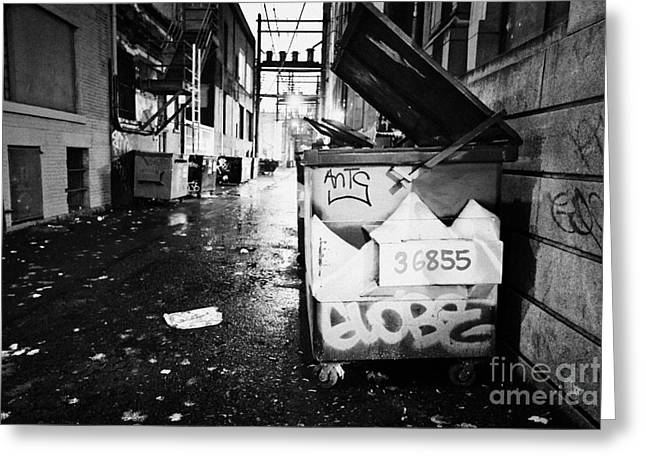 American Grafitti Greeting Cards - large open refuse bins in an alleyway at night downtown Vancouver BC Canada Greeting Card by Joe Fox