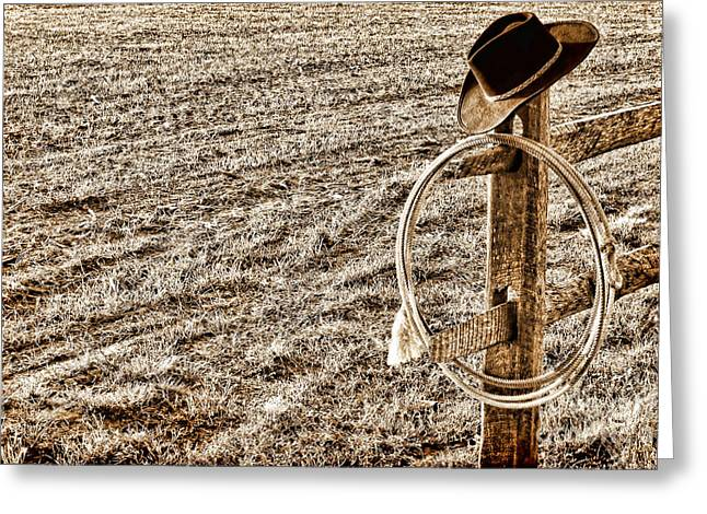 Lasso And Hat On Fence Post Greeting Card by Olivier Le Queinec