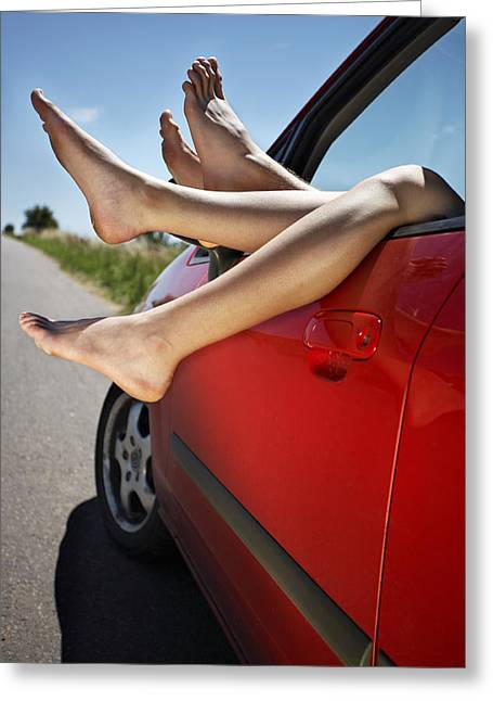 Pause Greeting Cards - Legs poking out of the car Greeting Card by Radka Linkova