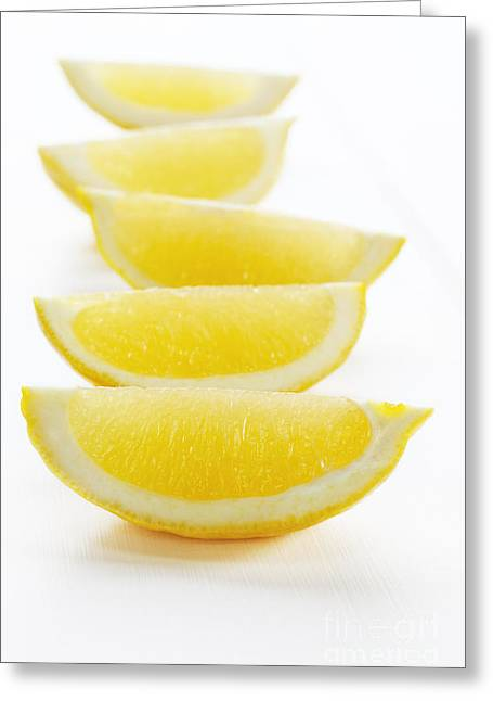 Lemon Wedges On White Background Greeting Card by Colin and Linda McKie