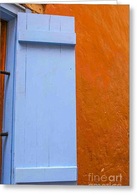 Bright. Table Greeting Cards - Light blue shutter against orange wall Greeting Card by Patricia Hofmeester