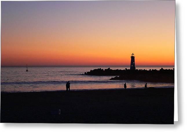 The Santa Cruz Harbor Lighthouse Greeting Cards - Lighthouse and Lovers At Sunset Greeting Card by Jeff Lowe