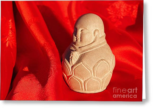Praying Hands Greeting Cards - Limestone Buddha on Red Silk Greeting Card by Anna Lisa Yoder