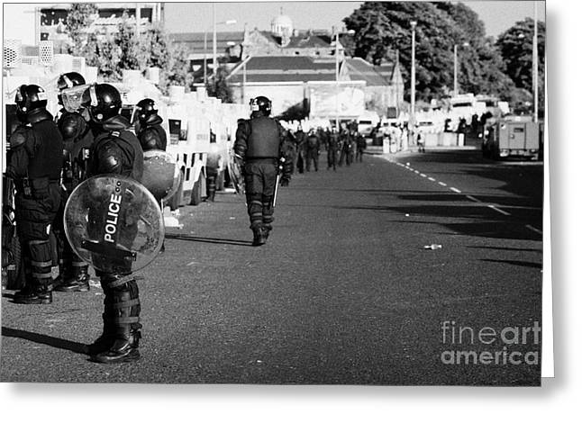 Terrorism Greeting Cards - Line of PSNI officers and land rovers in riot gear on crumlin road at ardoyne shops belfast 12th Jul Greeting Card by Joe Fox