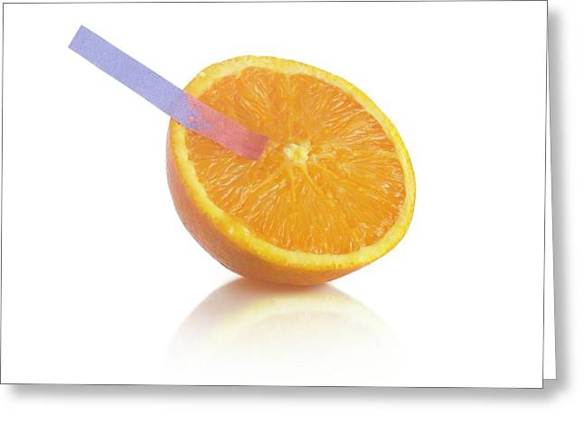 Litmus Paper Test On An Orange Greeting Card by Science Photo Library