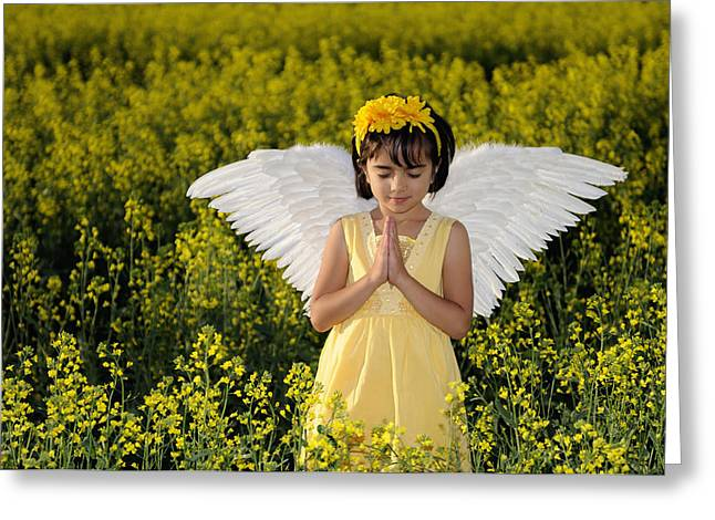 Praying Hands Greeting Cards - Little Angel Praying In A Field Of Yellow Flowers Greeting Card by Kriss Russell