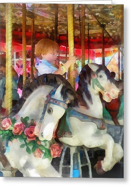 Little Boy On Carousel Greeting Card by Susan Savad