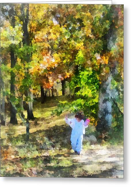 Dappled Sunlight Greeting Cards - Little Girl Walking in Autumn Woods Greeting Card by Susan Savad