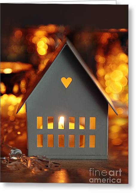 Bright Decor Greeting Cards - Little gray house lit with candle for the holidays Greeting Card by Sandra Cunningham