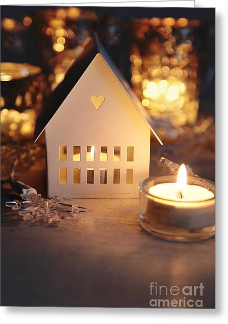 Little Cabin Greeting Cards - Little white house lit with candle for the holidays Greeting Card by Sandra Cunningham