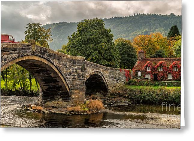 Stone Bridge Greeting Cards - Llanrwst Cottage Greeting Card by Adrian Evans