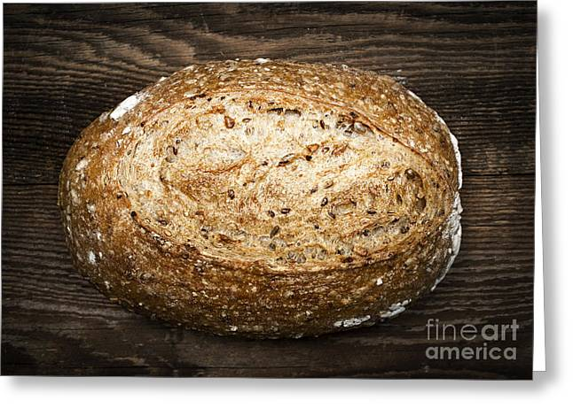 Bread Loaf Greeting Cards - Loaf of multigrain artisan bread Greeting Card by Elena Elisseeva