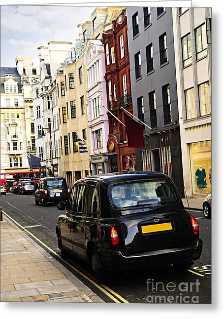 Townhouses Greeting Cards - London taxi on shopping street Greeting Card by Elena Elisseeva