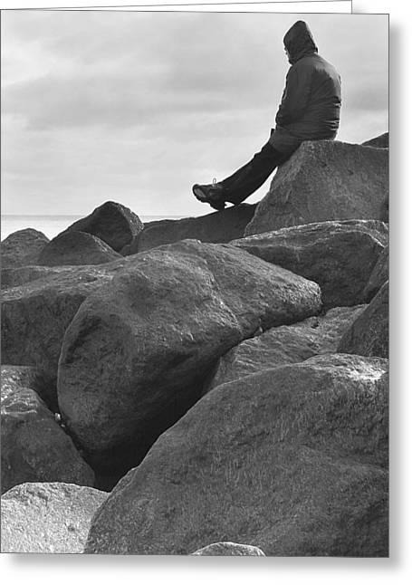 Coastal Decor Digital Greeting Cards - Lone Man Sitting on Rocky Beach Greeting Card by Natalie Kinnear