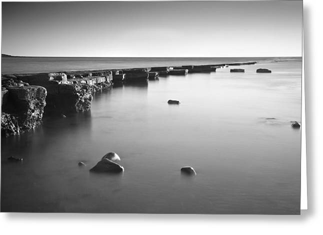 Ledge Photographs Greeting Cards - Long exposure image of tide going out over rock ledge during sun Greeting Card by Matthew Gibson