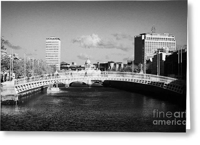 looking down the liffey towards the hapenny ha penny bridge over the river liffey in dublin Greeting Card by Joe Fox