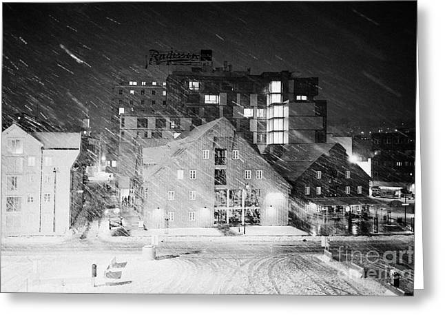 Snowy Evening Greeting Cards - looking out atTromso bryggen quay harbour on a cold snowy winter night troms Norway europe Greeting Card by Joe Fox