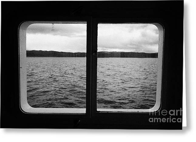 Cabin Window Greeting Cards - looking out of ships windows at the Beagle Channel and Isla Navarino Tierra Del Fuego Chile Greeting Card by Joe Fox