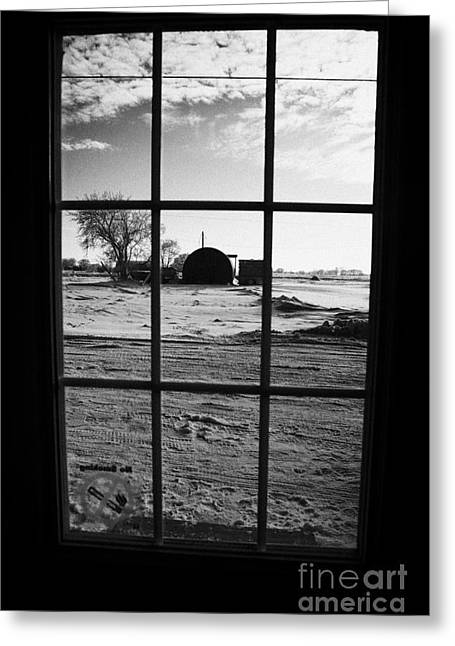 Harsh Conditions Photographs Greeting Cards - looking out through door window to snow covered scene in small rural village of Forget Greeting Card by Joe Fox
