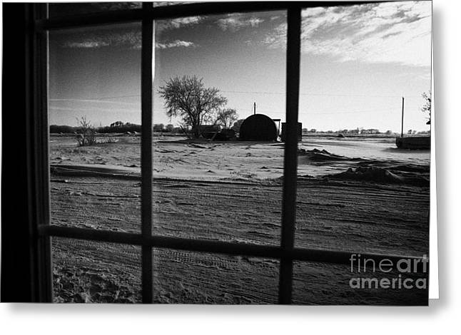 Harsh Conditions Photographs Greeting Cards - looking out through door window to snow covered scene in small rural village of Forget Saskatchewan  Greeting Card by Joe Fox
