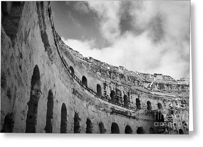 African Heritage Greeting Cards - Looking Up At Blue Cloudy Sky And Upper Tiers Of The Old Roman Colloseum At El Jem Tunisia Greeting Card by Joe Fox