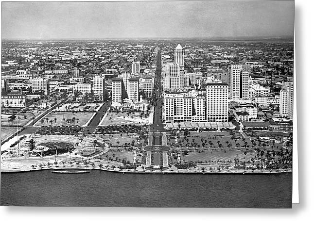 Looking Up Flagler Street At Downtown Miami Greeting Card by Underwood Archives