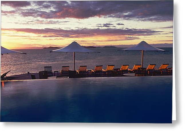 Lounge Chairs Greeting Cards - Lounge Chairs And Patio Umbrellas Greeting Card by Panoramic Images