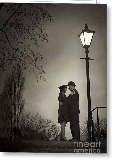 Night Lamp Greeting Cards - Lovers Embracing Under A Street Light Greeting Card by Lee Avison