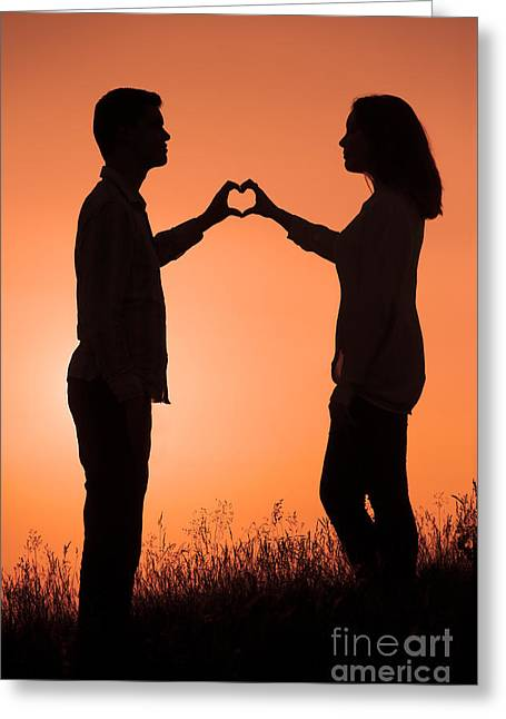 Woman In Summer Meadow Greeting Cards - Lovers Making A Heart Shape At Sunset Greeting Card by Lee Avison