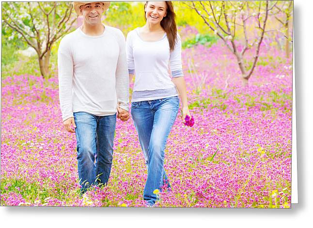 Green Flower Hat Greeting Cards - Loving family walk in park Greeting Card by Anna Omelchenko