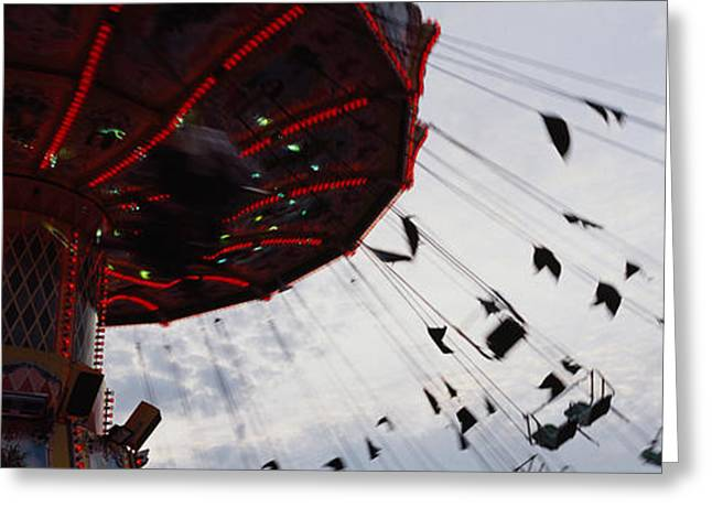 Amusements Greeting Cards - Low Angle View Of A Ferris Wheel In An Greeting Card by Panoramic Images