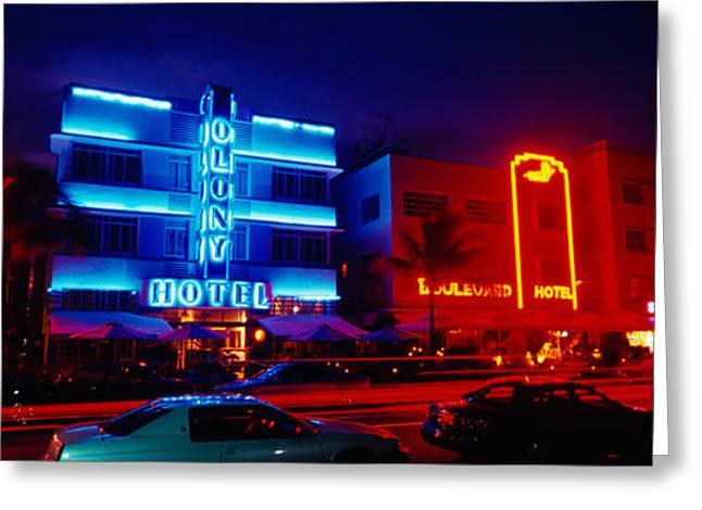Script Greeting Cards - Low Angle View Of A Hotel Lit Up At Greeting Card by Panoramic Images