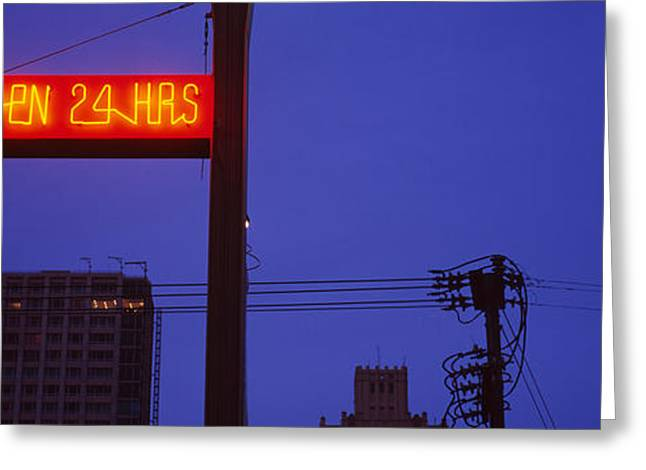 Business-travel Greeting Cards - Low Angle View Of A Neon Sign, San Greeting Card by Panoramic Images