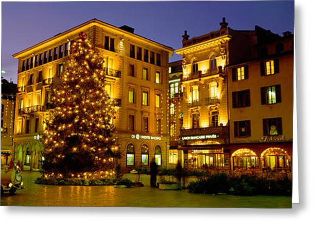 Winter Night Greeting Cards - Low Angle View Of Buildings, Piazza Greeting Card by Panoramic Images