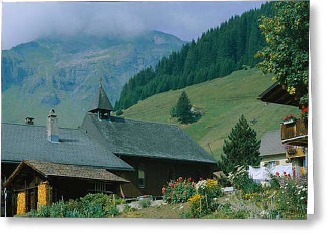 Swiss Photographs Greeting Cards - Low Angle View Of Houses On A Mountain Greeting Card by Panoramic Images