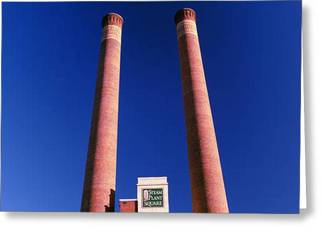 Low Angle View Of Two Smoke Stacks Greeting Card by Panoramic Images