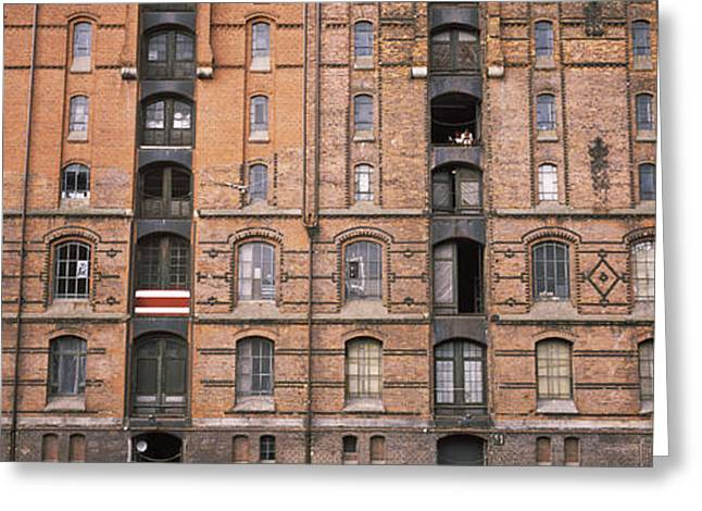 Repetition Greeting Cards - Low Angle View Of Warehouses In A City Greeting Card by Panoramic Images