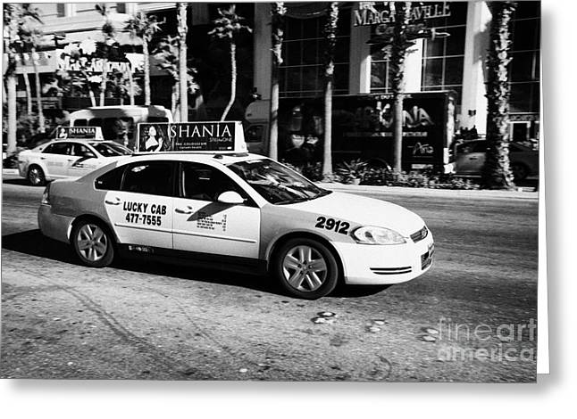 Speeding Taxi Greeting Cards - lucky cab speeding down Las Vegas boulevard Nevada USA deliberate motion blur Greeting Card by Joe Fox