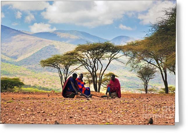 Recently Sold -  - Apparel Greeting Cards - Maasai men sitting. Savannah landscape in Tanzania Greeting Card by Michal Bednarek