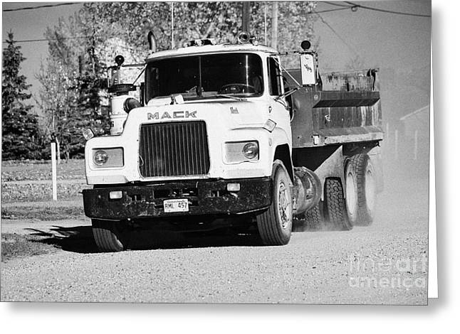 Localities Greeting Cards - mack truck driving down rough unpaved rural road in farming community Saskatchewan Canada Greeting Card by Joe Fox