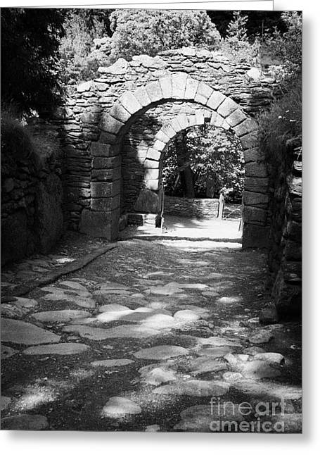 Significance Greeting Cards - main entrance gateway to Glendalough monastery archeological site Greeting Card by Joe Fox
