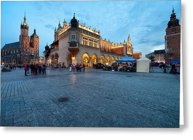 Polish Old Town Greeting Cards - Main Square in the Old Town of Krakow in Poland at Dusk Greeting Card by Artur Bogacki