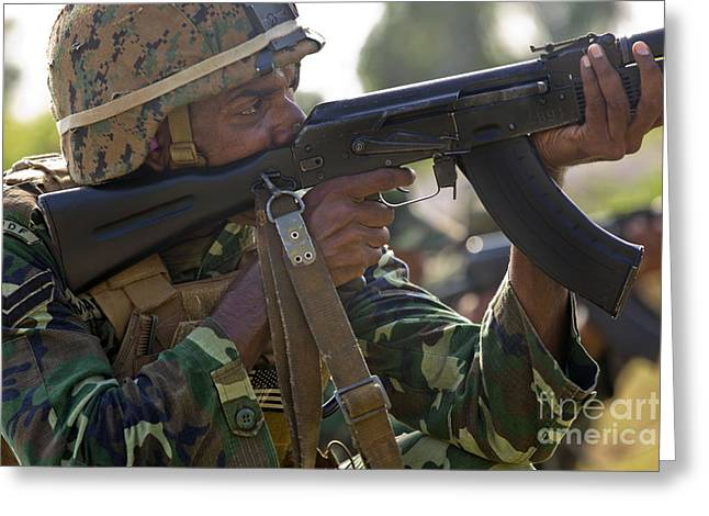 Ak 47 Greeting Cards - Maldivian Marine Fires An Ak-47 Service Greeting Card by Stocktrek Images